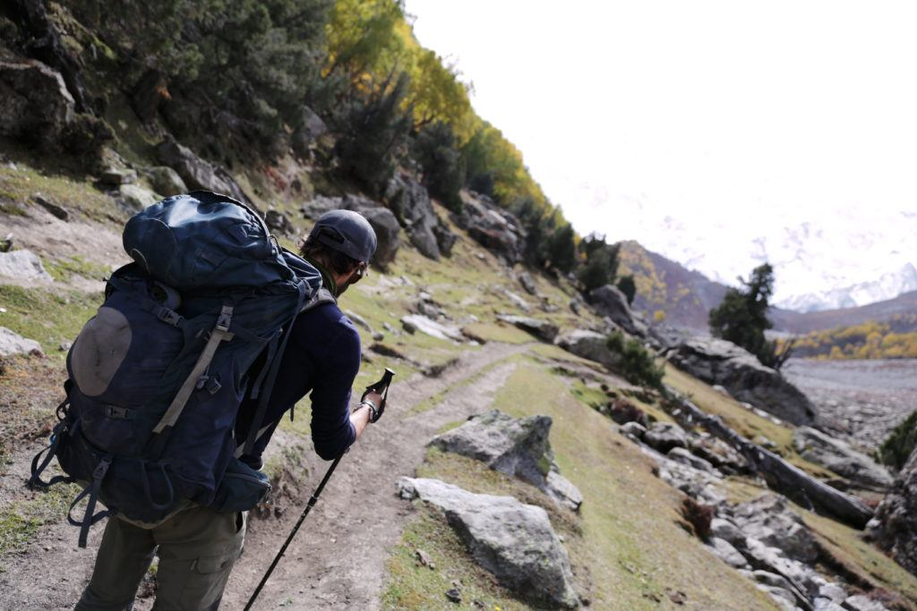 Man hiking with his ultralight backpacking gear