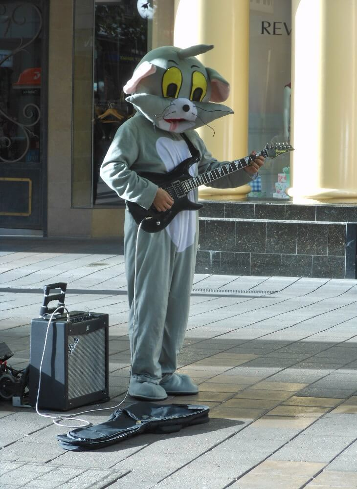 Busker traveler with his electric gitar