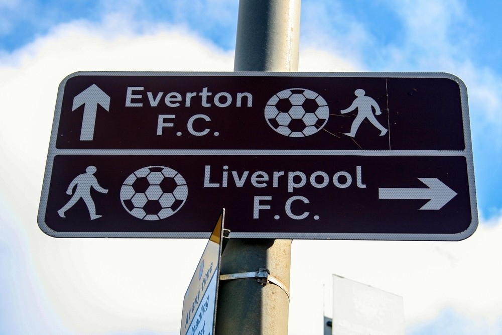 Choose your side between Liverpool F.C. or Everton F.C.
